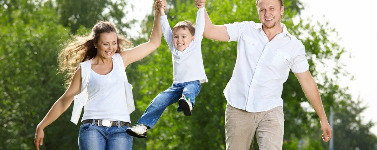 Parents with the small son frolic on the nature